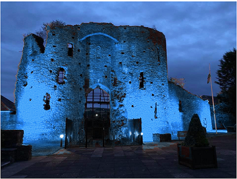 Neath Castle lit blue