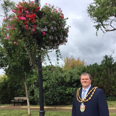 Mayor with hanging basket